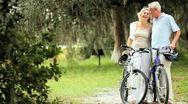 Stock Video Footage of Active Mature Couple Cycling for Exercise