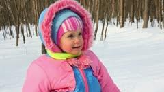 Baby girl walking in winter park Stock Footage