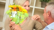 Stock Video Footage of Attractive Lady Surprised with Fresh Flowers