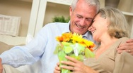 Stock Video Footage of Mature Female with Flowers from Husband