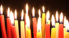 Burning red, yellow and white candles. Stock Footage