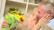 Stock Video Footage of Mature Lady with Flowers from Husband