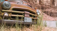 A tracking shot of an old rusting pickup truck. - stock footage