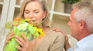 Stock Video Footage of Attractive Female with Flowers from Husband