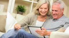 Senior Couple Having Fun with a Wireless Tablet Stock Footage