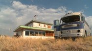Stock Video Footage of Time lapse of an abandoned Greyhound bus in a field.