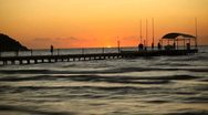 People walking the sea pontoon at sunset. Fast time lapse. Stock Footage