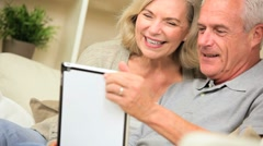 Retired Couple Using Online Webchat Stock Footage