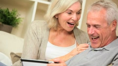 Excited Senior Couple Having Success Online Stock Footage