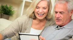 Retired Caucasian Couple Using a Wireless Tablet - stock footage