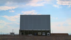 A shot of clouds passing over an abandoned drive in theater screen. - stock footage