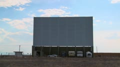 A shot of clouds passing over an abandoned drive in theater screen. Stock Footage