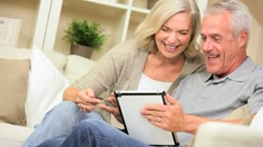 Mature Couple Having Fun with a Wireless Tablet Stock Footage