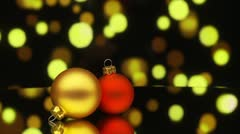 Two christmas baubles rotating with bokeh Stock Footage
