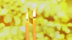 Three candles rotating on reflective surface Stock Footage