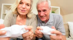Attractive Older Couple Playing Wireless Electronic Games Stock Footage