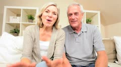 Stock Video Footage of Retired Couple Using Online Webchat Communication