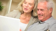 Senior Couple Using Online Webchat Communication Stock Footage