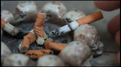 Cigarette butts in the ashtray - stock footage