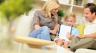 Family Using Online Web Chat Talking to Friends Stock Footage