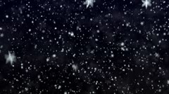 Stock Video Footage of Snowfall on darkly dark blue background. Snowflakes.