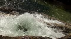 Close up of water fountain in rocks - stock footage