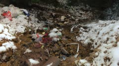 Polluted mountain creek Stock Footage