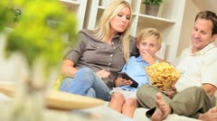 Young Family Watching Movie Together with Snacks Stock Footage