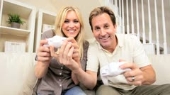 Young Caucasian Couple Playing on Games Console Stock Footage