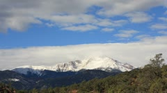 Stock Video Footage of Clouds Rush over Snow Covered Pikes Peak Mountain Timelapse