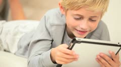 Little Boy Using Wireless Tablet Stock Footage