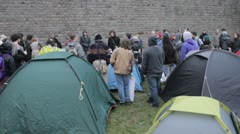 Protesters listen round tents Stock Footage