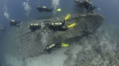 Scuba Divers exploring outside of a shipwreck (SS Dunraven) Stock Footage