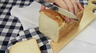 Stock Video Footage of Slicing Crusty Bread 1