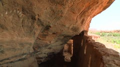High angle view of an ancient Indian dwelling in a cliff face in Utah. - stock footage