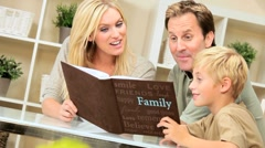 Young Caucasian Family with Photograph Album Stock Footage