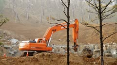 Excavator inserting scoop Stock Footage