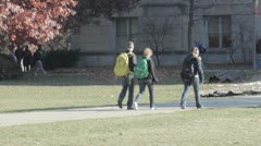 Stock Footage College Students in Fall - Walking to class, skateboard - stock footage