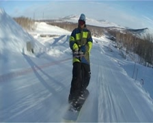 Snowboarder jumping in the snowpark Stock Footage