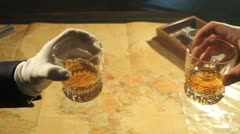 Toasting whiskey glass Stock Footage