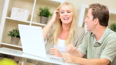 Young Caucasian Couple Having Success Online Stock Footage