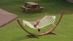 Girl in hammock Stock Footage