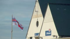 RNLI Lifeboat Station and Flag Stock Footage