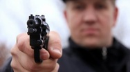 Man shooting with revolver Stock Footage