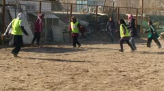 Afghan women playing football in the schoolyard - stock footage