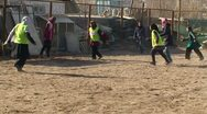 Afghan women playing football in the schoolyard Stock Footage