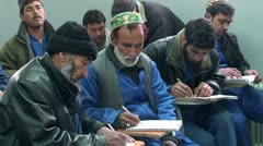 Afghans men learning in the school Stock Footage