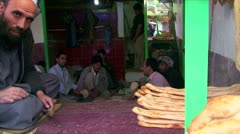 Afghan workers in a bakery on the streets of Kabul Stock Footage