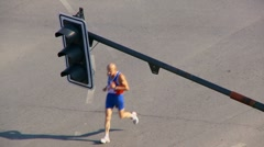 Competitors run a marathon through the city slow motion Stock Footage