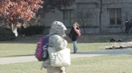 Stock Footage College Students in Fall - walking, leaves blowing Stock Footage